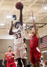 Riverdale High School's Isaiah Jones scores against Palmetto on Thursday in the Class 8A regional quarterfinal at Riverdale in Fort Myers. Riverdale beat Palmetto 61-54.