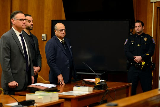 Marc Messing, suspended Palisades Park Police Sergeant stands in court between his attorneys Ken Ralph, left, and John Bruno for a competency hearing before Bergen County Superior Court Judge Margaret M. Foti in Hackensack on Friday February 22, 2019. Messing is accused of altering a check written to the municipality in 2015.
