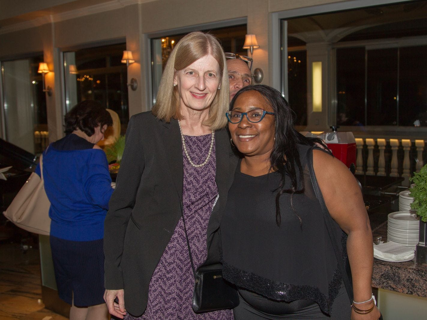 Ellen Kuhn, Kisha Evan. Eva's Village hosted its second annual Lawyers, Accountants and Financial Professionals Benefit Dinner at Westmount Country Club in Woodland Park. 02/21/2019