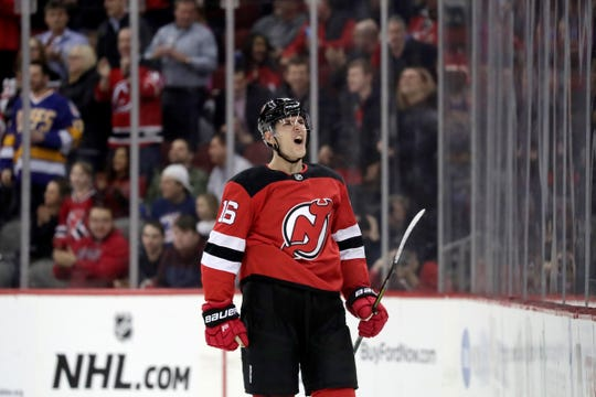 New Jersey Devils defenseman Steven Santini reacts after scoring a goal against the Ottawa Senators during the first period of an NHL hockey game, Thursday, Feb. 21, 2019, in Newark, N.J.