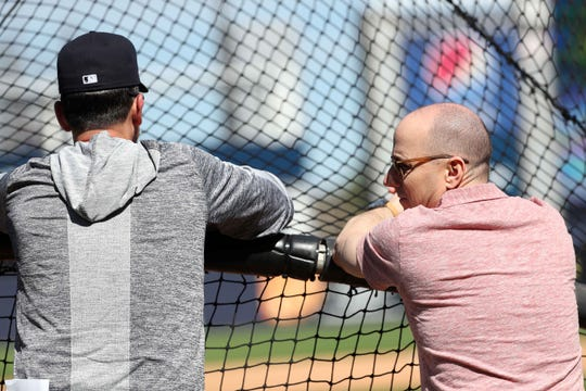New York Yankees general manager Brian Cashman and manager Aaron Boone (17) during spring training at George M. Steinbrenner Field.
