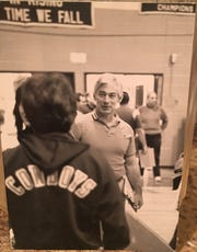 Ogasawara, back to camera, with coach Bucky Rehain. Ogasawara said wrestling put her in the best shape of her life.