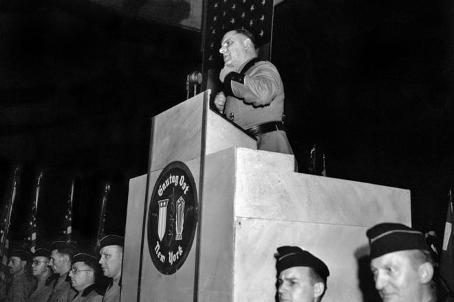 """FILE - This Feb. 20,1939 file photo shows Fritz Kuhn, national leader of the Bund, in the full uniform of a Storm Trooper, as he speaks from the rostrum at Madison Square Garden in New York. The pro-Hitler rally that took place 80 years ago this week at New York's Madison Square Garden is the subject of a short documentary that's up for an Oscar this Sunday, Feb. 24, 2019. The film directed by Marshall Curry is called a """"A Night at the Garden."""" (AP Photo, File)"""