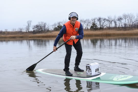 CEO Sam Calagione paddles a case of Dogfish Head spirits to New Jersey.