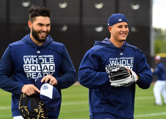 Feb 22, 2019; Peoria, AZ, USA;  San Diego Padres third baseman Manny Machado (13) talks with first baseman Eric Hosmer (30) as they walk off the field after playing catch at the Peoria Sports Complex.