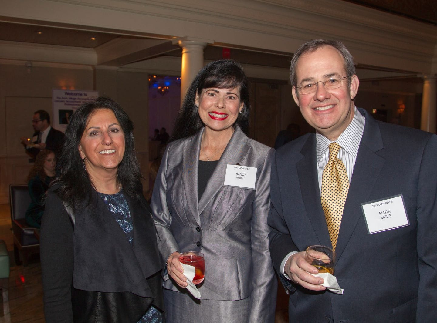 maria Geiger, nancy Mele, Mark Mele. Eva's Village hosted its second annual Lawyers, Accountants and Financial Professionals Benefit Dinner at Westmount Country Club in Woodland Park. 02/21/2019