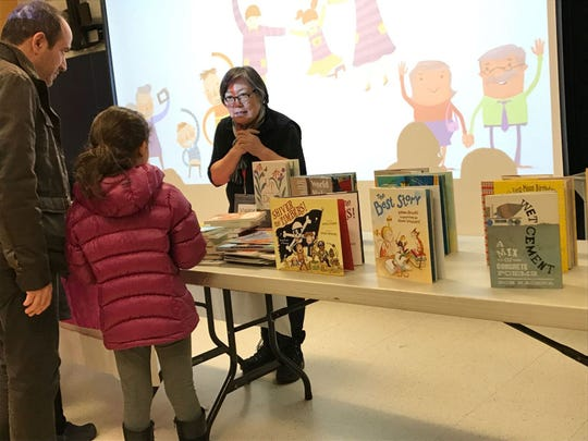 Author Janet Wong speaks with parents and students at River Edge's Cherry Hill Elementary School during a Family Poetry Night on Feb. 21