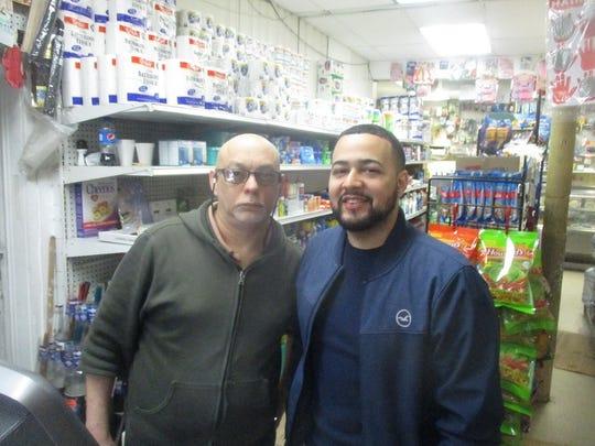 Jose Alba, manager of the Consuela Mini Market in Paterson's 1st Ward, with his son, Jose Alba Jr.