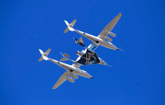 Virgin Galactic's VSS Unity rocket plane flown into the atmosphere before launching Friday, Feb. 22, 2019, in  Mojave, Calif. Virgin Galactic says its rocket plane has reached space for a second time in a test flight over California on Friday. In addition to two pilots, the spacecraft carried a third crewmember to evaluate the cabin from a passenger perspective.