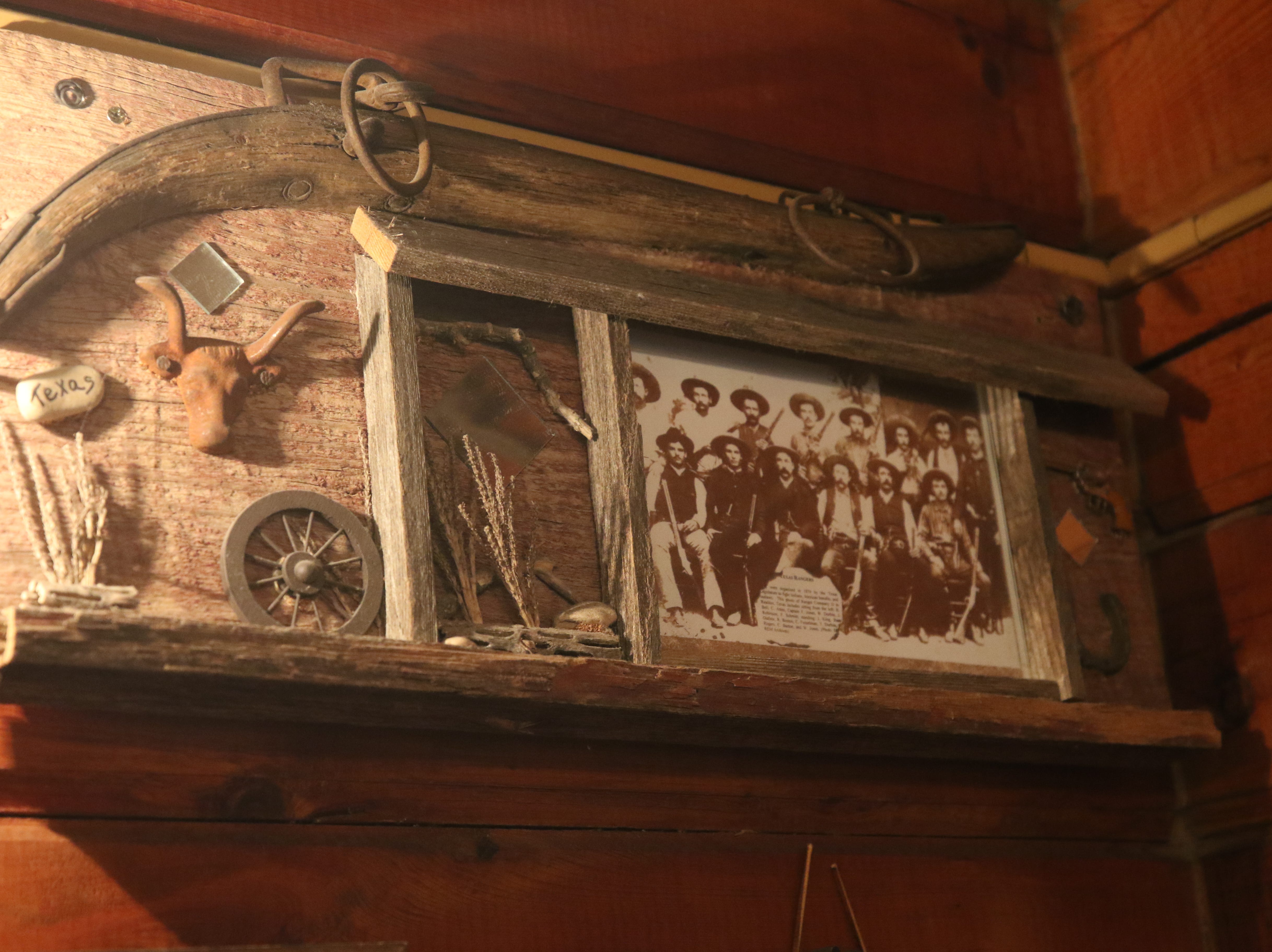 Various historical artifacts adorn the wall at Red Chimney Bar-B-Q in Carlsbad.