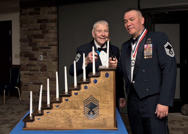 (From left to right) Robert D. Gaylor, fifth Chief Master Sgt. of the Air Force and Senior Master Sgt. John Chacon, 49th Civil Engineer Squadron superintendent, light the chief candle,  Feb. 15, 2019, at Club Holloman on Holloman Air Force Base, N.M. Gaylor was the guest speaker at the Chief Recognition Ceremony where Chacon was recognized as a chief select.