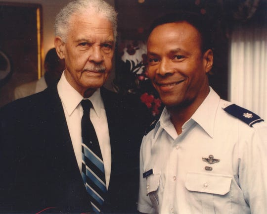 "Retired General Benjamin O. Davis Jr., former 99th Pursuit Squadron and 332nd Fighter Group commander, poses with retired Lt. Col. Larry ""Jet"" Jackson, Tuskegee Airmen Incorporated Western Region mentor."