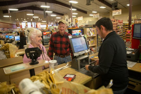 Judy and Jack Richards talk with cashier Tony Maestas, Thursday, Jan. 12, 2017 at the Farmer's Market in Flora Vista.