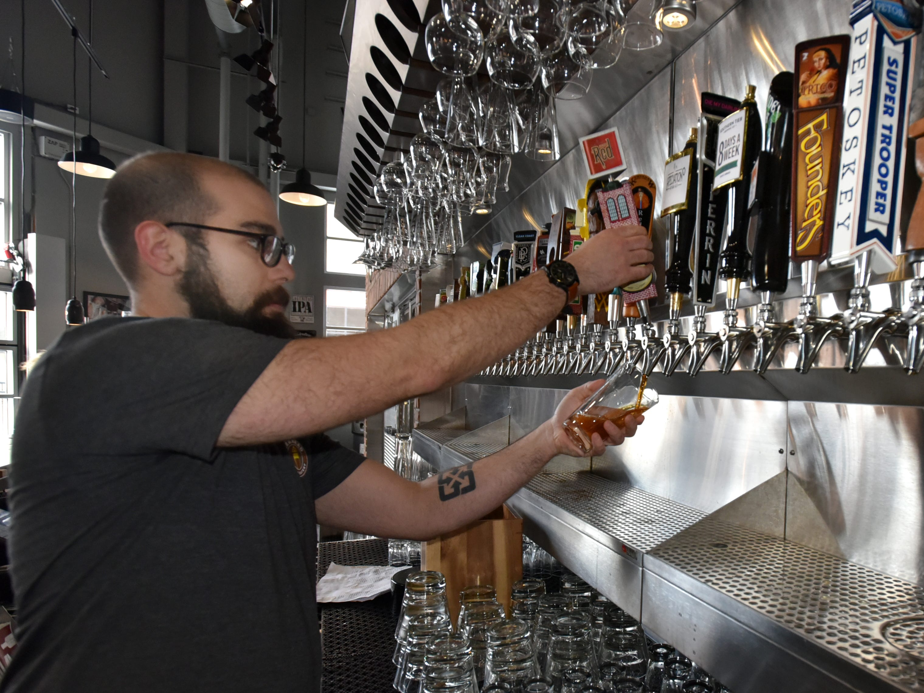 Beerhead bartender Jon Jorge pulls a Rochester Mills Ale on Feb. 21 at the Novi location inside Fountain Walk.