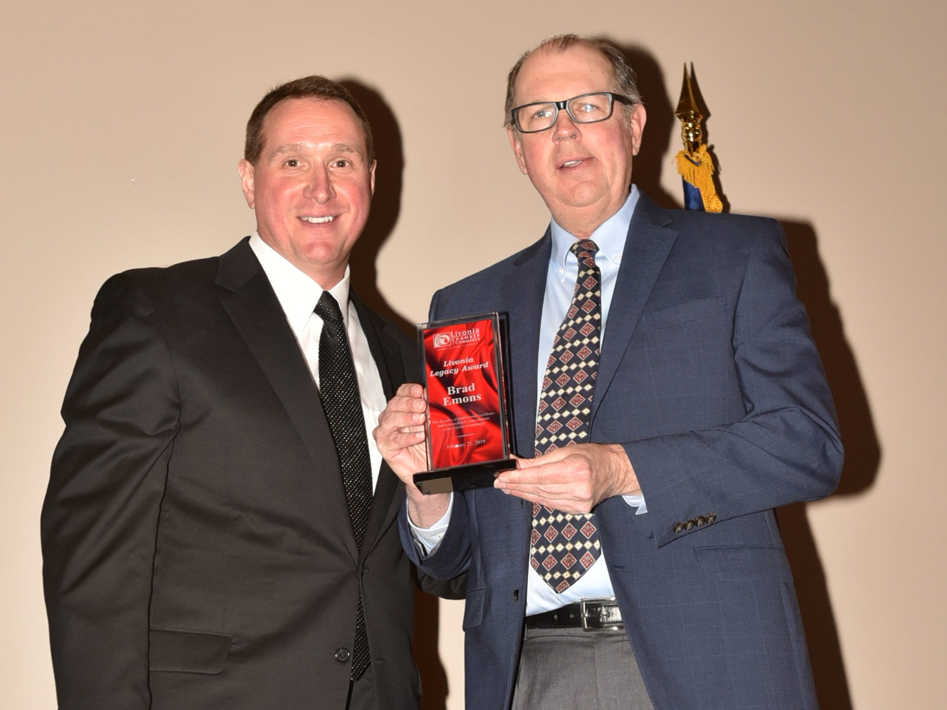 Recently-retired O&E sports reporter Brad Emons, right, is honored by the Livonia Chamber for its Livonia Legacy Award. Emons wrote for the newspapers and hometownlife.com for 41 years and retired in early February. Livonia Chamber of Commerce's Dan West is at left.
