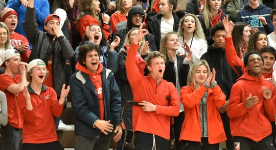 Canton students cheer another three-pointer from their Chiefs on Feb. 21.
