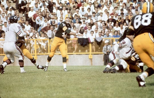 Bart Starr throws a pass against the Chicago Bears on Sept. 13, 1964, toward receiver Ron Kramer (88). The Packers won 23-12.