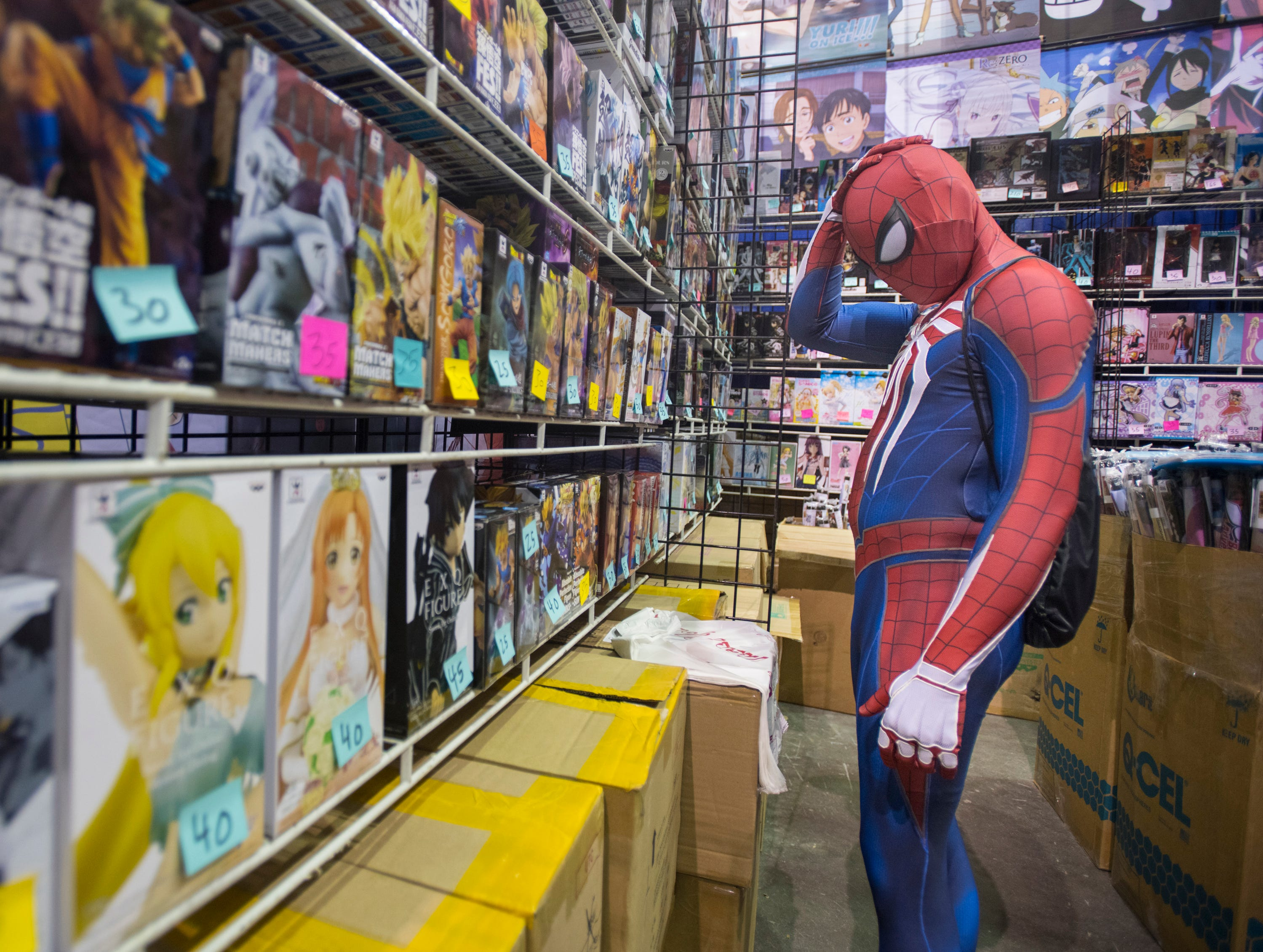 Spiderman - AKA Caleb Stead, of Milton, shops during Pensacon at the Pensacola Bay Center on Friday, February 22, 2019.