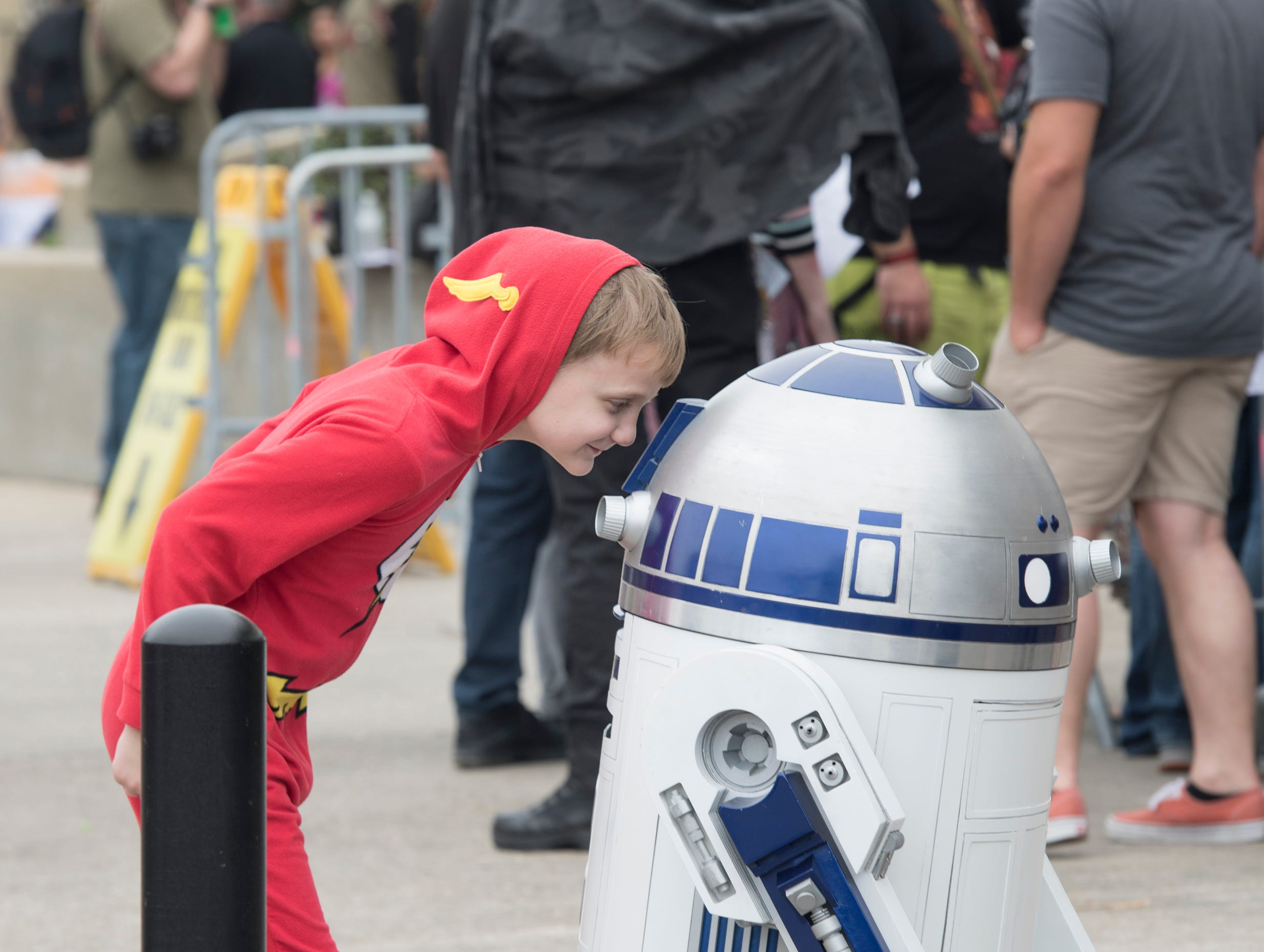 Nicholas Vintor, 9, of Loxley, Alabama, has a close encounter with a droid-kind during Pensacon at the Pensacola Bay Center on Friday, February 22, 2019.