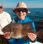 Clients with their triggerfish catch from a charter last year with Capt. Rick Barberi and Marlin Hunter Fishing Charters.