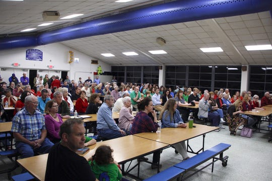 Residents listen to Pensacola Mayor Grover Robinson talk about proposed soccer fields at Scenic Heights Elementary School on Thursday, Feb. 21, 2018.