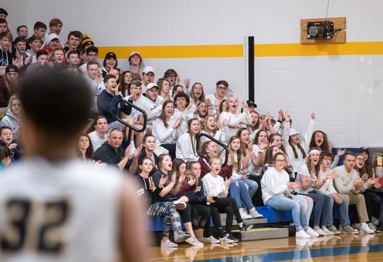 In this file photo, the Littlestown student section cheers after Jayden Weishaar (32) scores against Lancaster Catholic in the quarterfinals of the District 3 4-A playoffs Thursday, February 21, 2019.