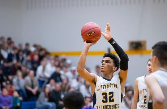 Littlestown's Jayden Weishaar prepares to shoot a free throw during play against Lancaster Catholic in the quarterfinals of the District 3 4-A playoffs Thursday, February 21, 2019. The Bolts fell 60-51.
