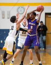 In this file photo, Littlestown's Jayden Weishaar (32) and Logan Collins pressure Lancaster Catholic's David Kamwanga in the quarterfinals of the District 3 4-A playoffs Thursday, February 21, 2019. The Bolts fell 60-51.