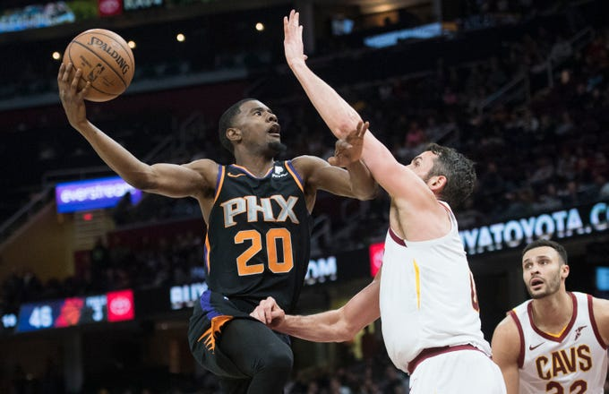 Feb 21, 2019; Cleveland, OH, USA; Phoenix Suns forward Josh Jackson (20) drives to the basket against Cleveland Cavaliers forward Kevin Love (0) during the first half at Quicken Loans Arena. Mandatory Credit: Ken Blaze-USA TODAY Sports