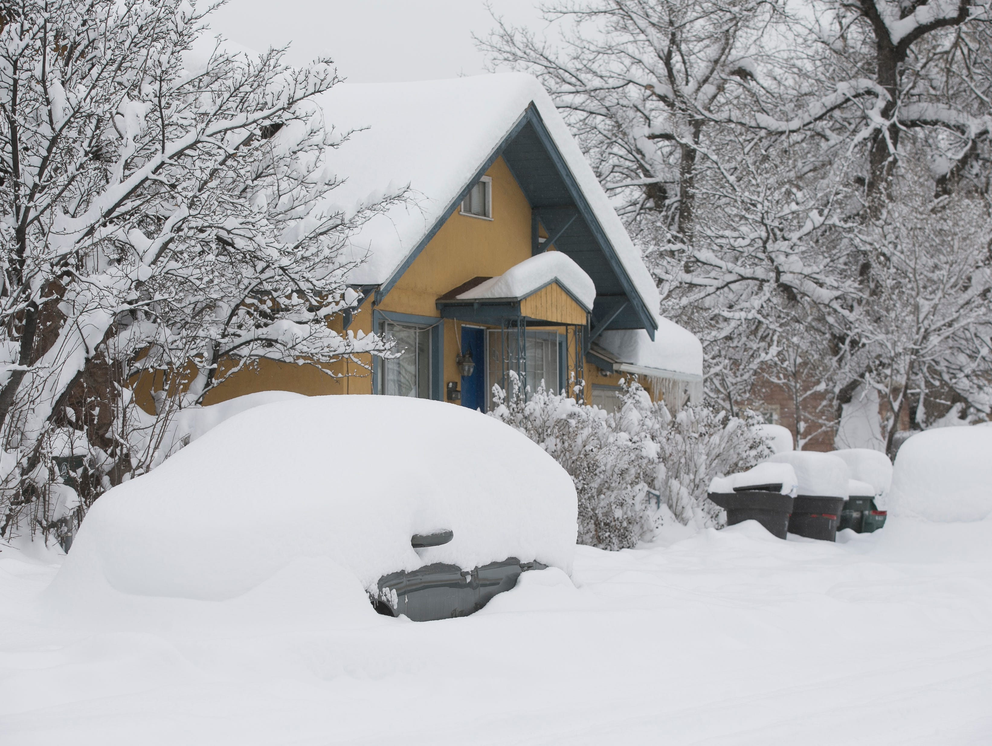 Snow blankets homes and cars the morning after a snowstorm in Flagstaff on Feb. 22, 2019. The day before, a snow storm set the record for the most amount of snowfall in a day in Flagstaff
