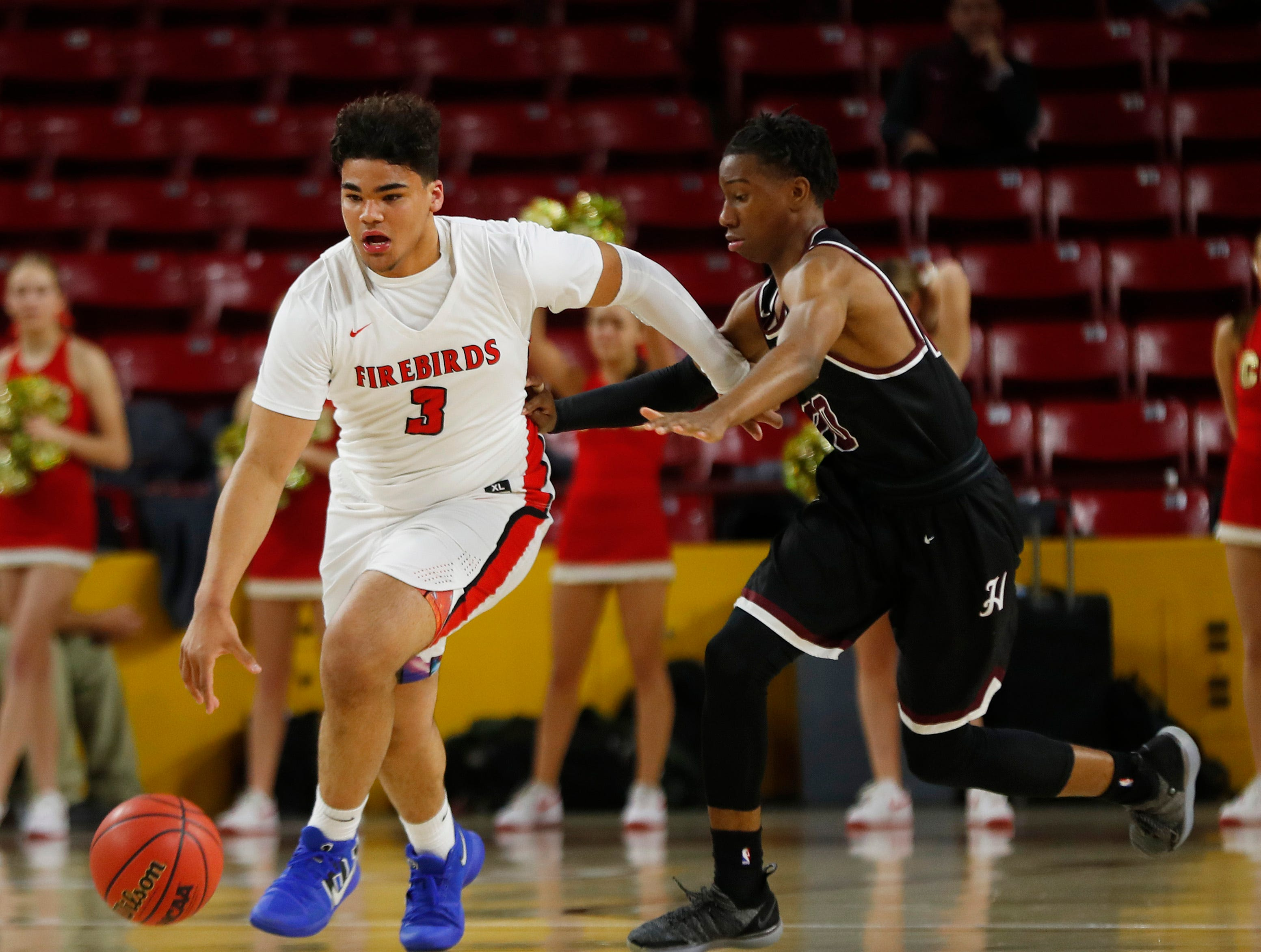 Chaparral's Blaise Threatt (3) dribbles up the court against Hamilton's Omar Knight (24) during first half of the 6A boys basketball semifinal game at Wells Fargo Arena in Tempe, Ariz. on February 21, 2019.