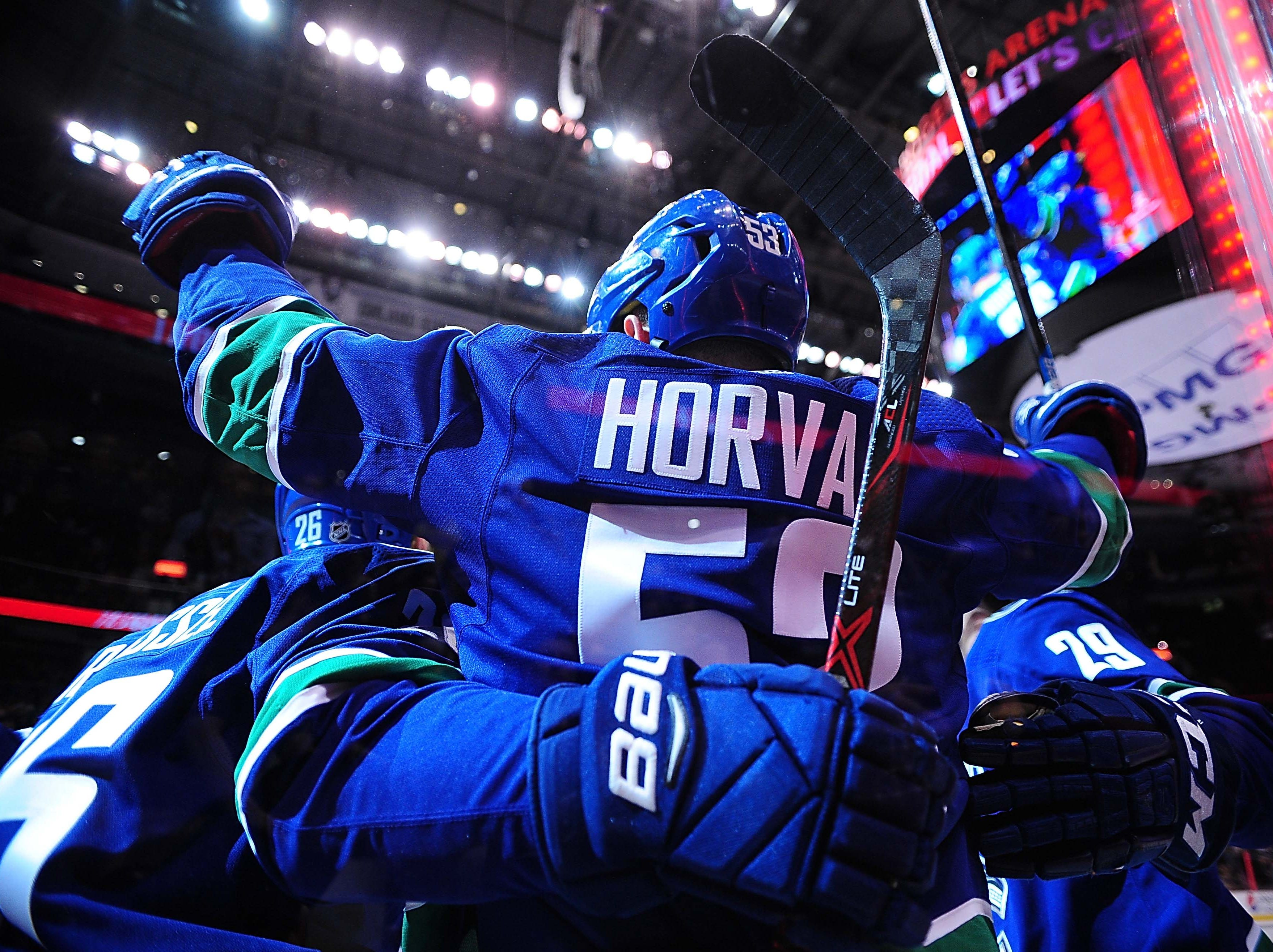 Feb 21, 2019; Vancouver, British Columbia, CAN; Vancouver Canucks forward Bo Horvat (53) celebrates his goal against Arizona Coyotes goaltender Darcy Kuemper (35) (not pictured) during the first period at Rogers Arena. Mandatory Credit: Anne-Marie Sorvin-USA TODAY Sports