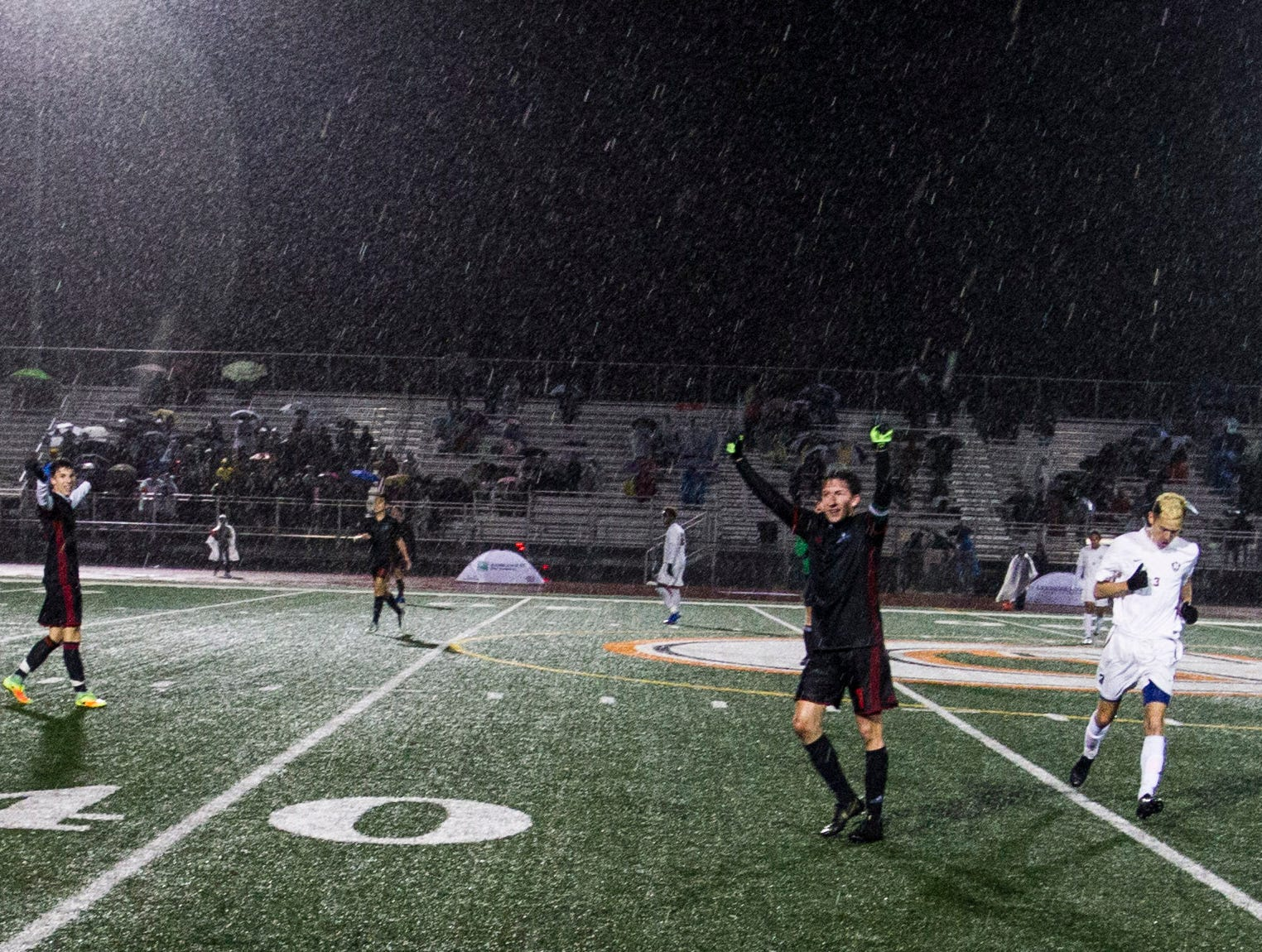 Brophy players celebrate in the rain after they won the 6A State Championship game over Hamilton 3-0 in Gilbert, Thursday, Feb 21, 2019.