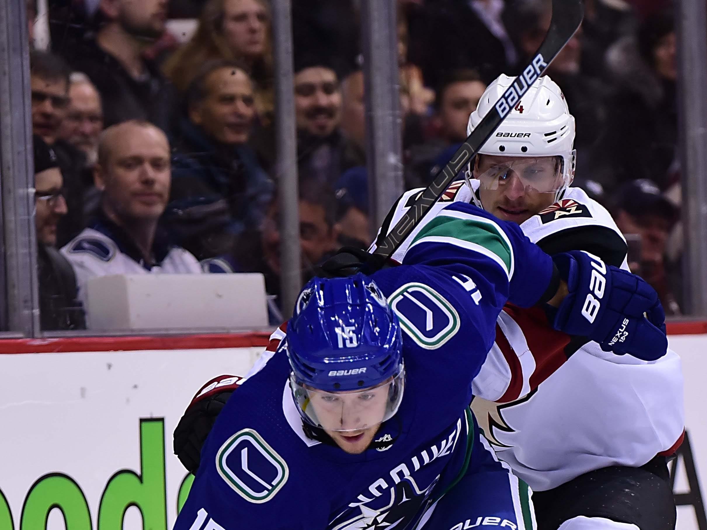 Feb 21, 2019; Vancouver, British Columbia, CAN; Arizona Coyotes forward Richard Panik (14) battles for the puck against Vancouver Canucks forward Ryan Spooner (15) during the first period at Rogers Arena. Mandatory Credit: Anne-Marie Sorvin-USA TODAY Sports