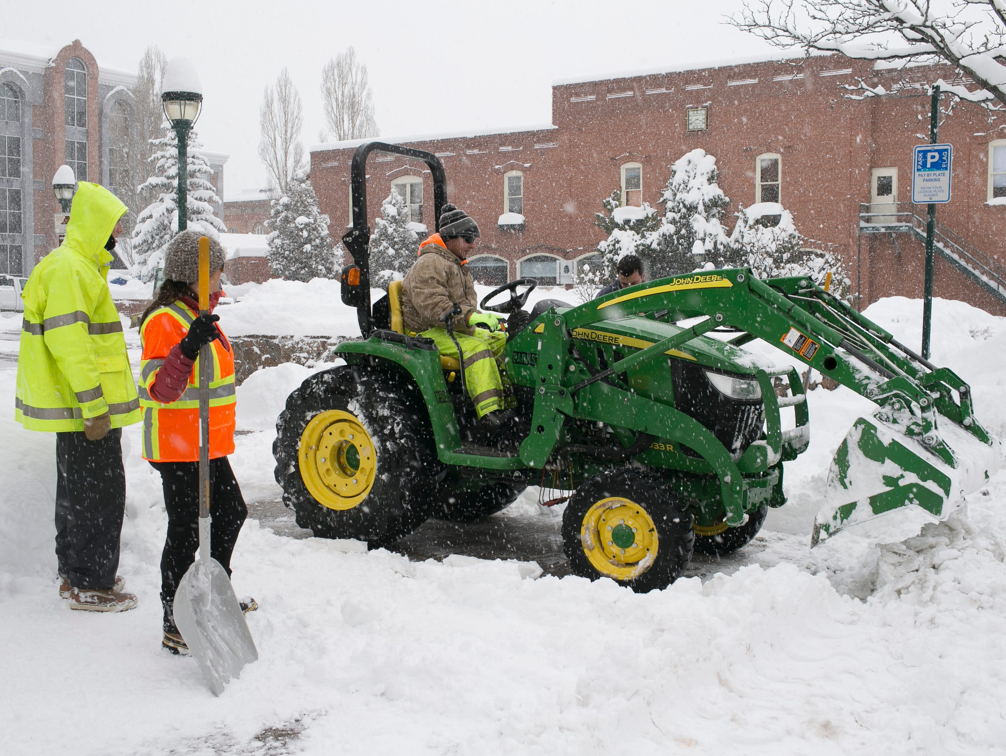 Cleaning up begins the morning after a snow storm in Flagstaff on Feb. 22, 2019.