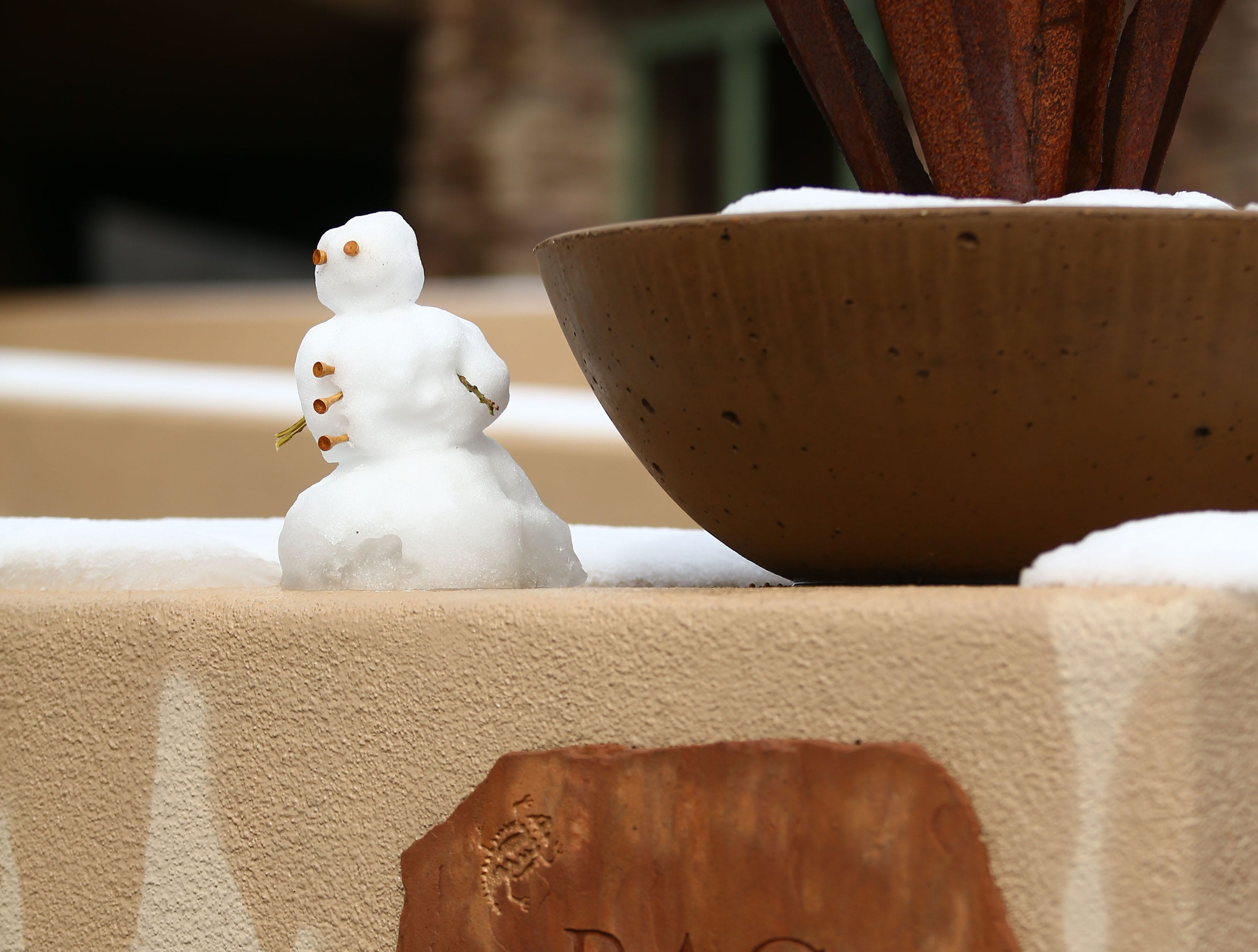 A snowman made with golf tees sits at Troon North Golf Club on Feb. 22, 2019, in Scottsdale.