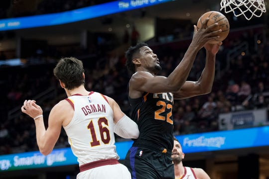 Feb 21, 2019; Cleveland, OH, USA; Phoenix Suns center Deandre Ayton (22) drives to the basket against Cleveland Cavaliers forward Cedi Osman (16) during the first half at Quicken Loans Arena. Mandatory Credit: Ken Blaze-USA TODAY Sports