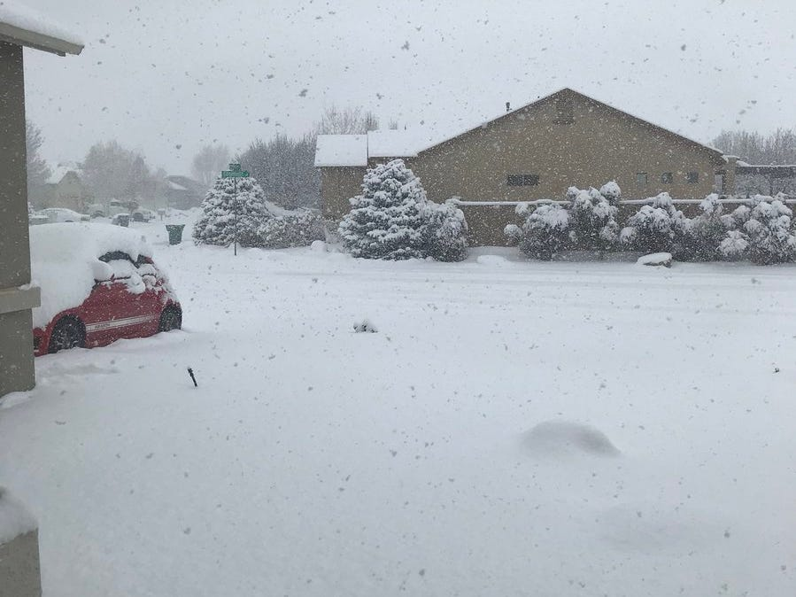 """SBWhisenhunt shared this image via Twitter saying """"Have we seen snow yet? It's still falling here in Prescott. #HunkerDown #EnoughAlready"""""""