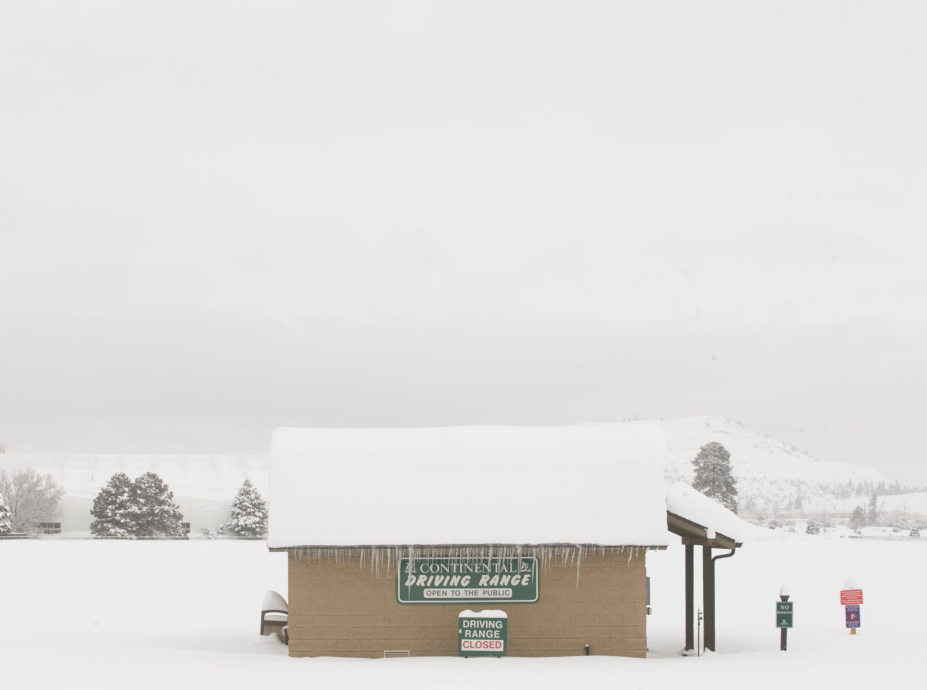 Snow covers a driving range at the Continental golf course the morning after a storm in Flagstaff on Feb. 22, 2019.