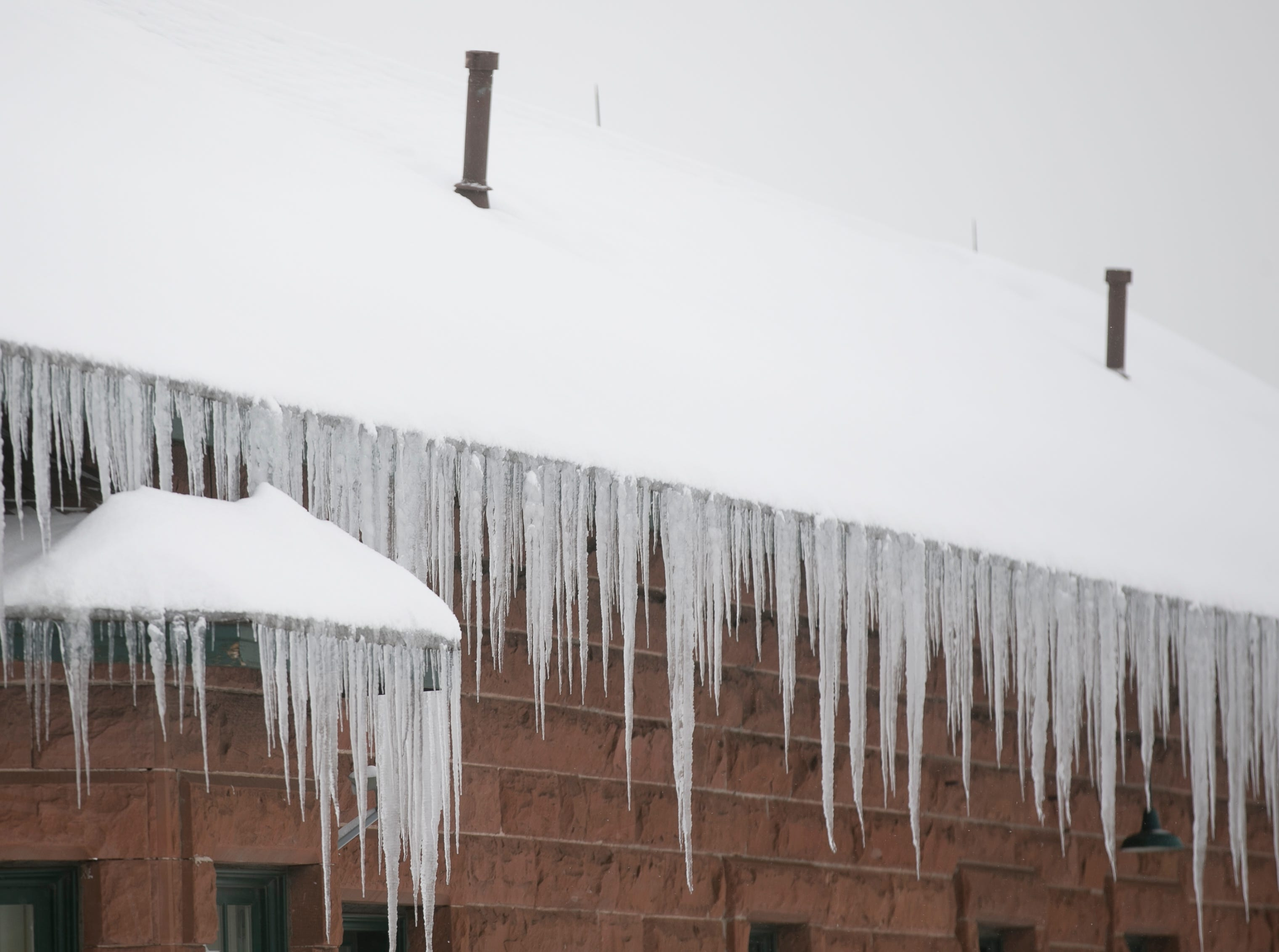 Icicles hang from a building the morning after a snowstorm in Flagstaff on Feb. 22, 2019. The day before, a snow storm set the record for the most amount of snowfall in a day in Flagstaff.
