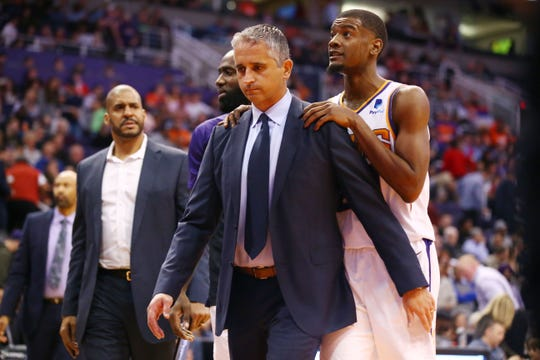 Suns coach Igor Kokoskov and Josh Jackson head to the locker room at halftime of a game against the Kings on Jan. 8 at Talking Stick Resort Arena.