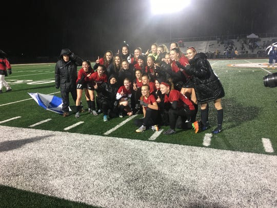 Chaparral girls soccer team celebrates winning the 6A girls soccer state championship.
