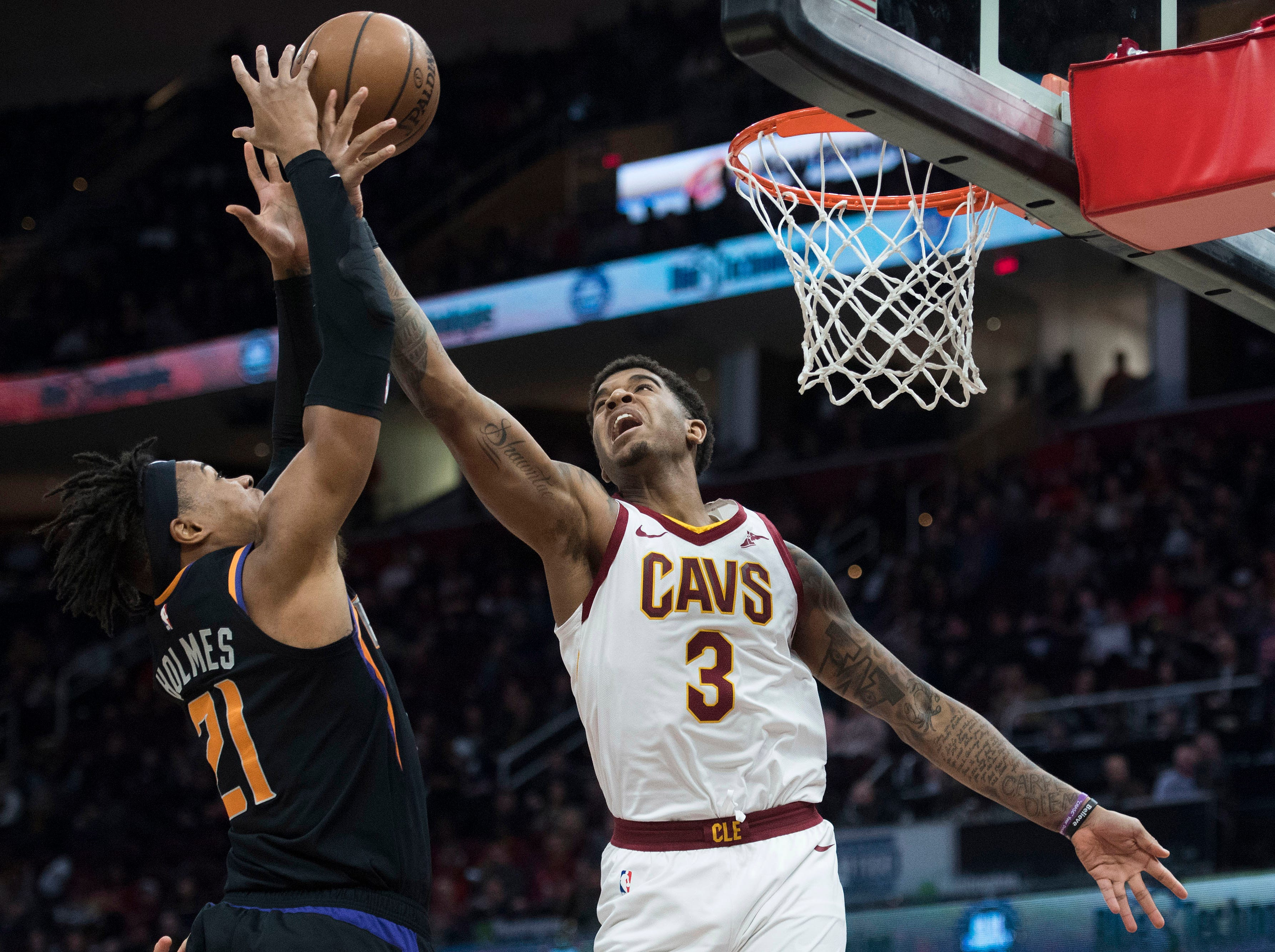 Feb 21, 2019; Cleveland, OH, USA; Phoenix Suns forward Richaun Holmes (21) and Cleveland Cavaliers forward Marquese Chriss (3) battle for a rebound during the second half at Quicken Loans Arena. Mandatory Credit: Ken Blaze-USA TODAY Sports