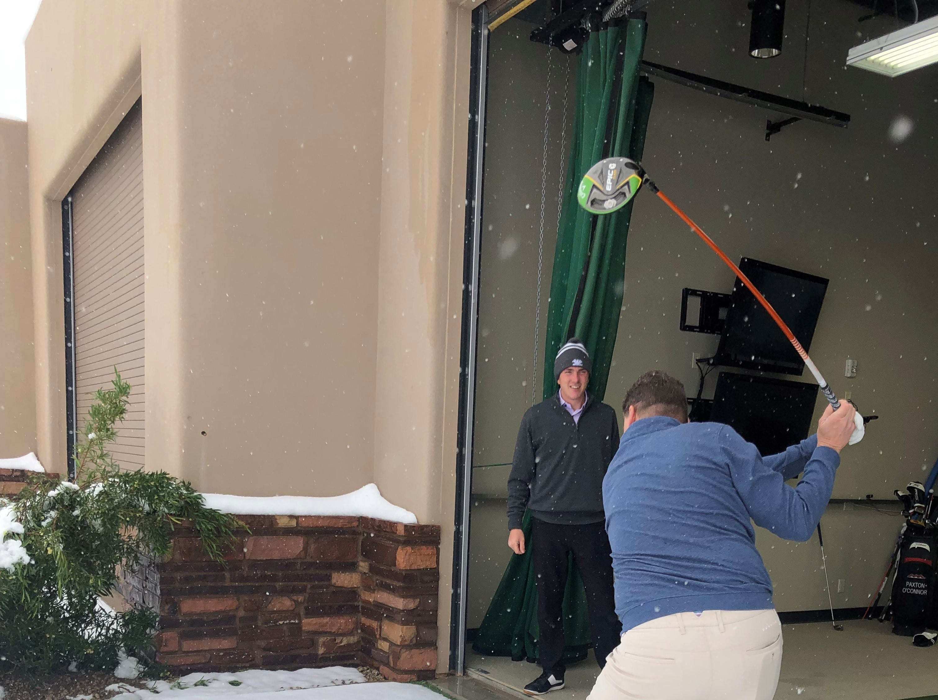 Members and staff play golf in the snow at Jim Flick Golf Performance Center at Desert Mountain Golf Club in Scottsdale.