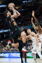 Feb 21, 2019; Cleveland, OH, USA; Phoenix Suns guard Tyler Johnson (16) drives to the basket against Cleveland Cavaliers guard Collin Sexton (2) during the first half at Quicken Loans Arena. Mandatory Credit: Ken Blaze-USA TODAY Sports