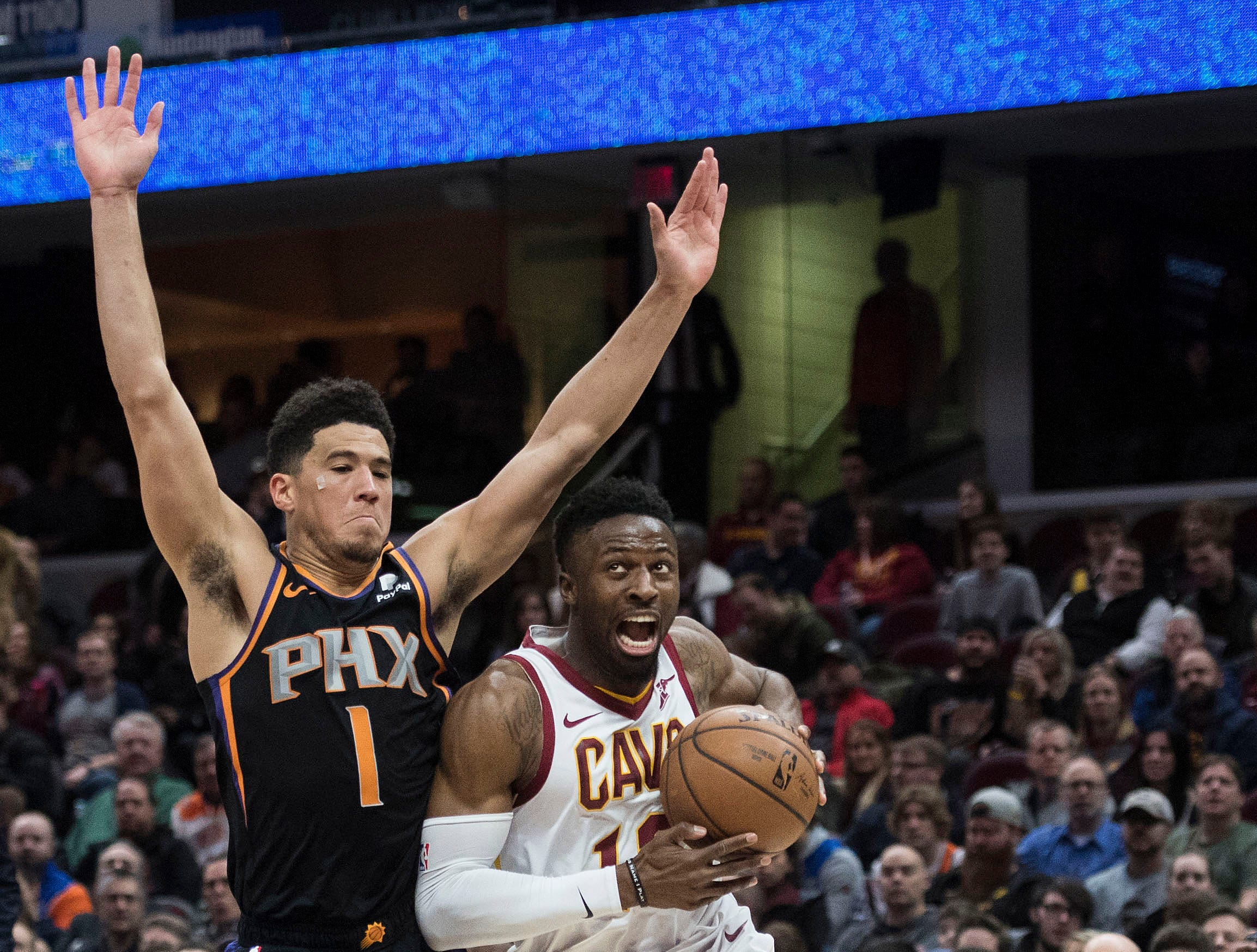 Feb 21, 2019; Cleveland, OH, USA; Cleveland Cavaliers guard David Nwaba (12) drives to the basket against Phoenix Suns guard Devin Booker (1) during the second half at Quicken Loans Arena. Mandatory Credit: Ken Blaze-USA TODAY Sports
