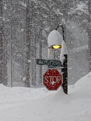 """Lisa Abernethy posted this photo to Twitter saying """"I don't think the stop sign will be visible much longer."""""""