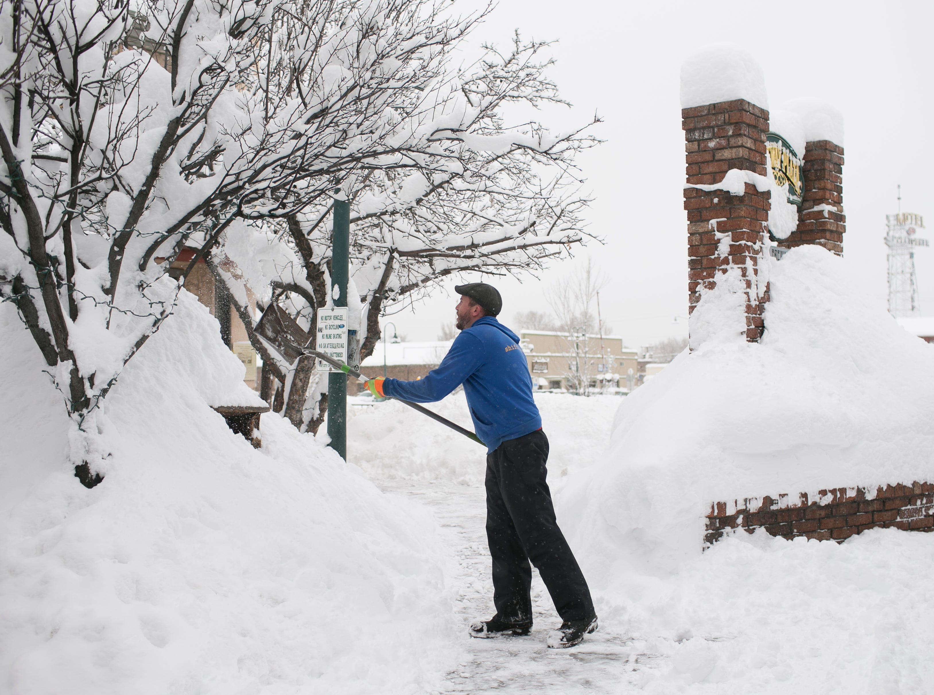 Mitch Kramer shovels snow the morning after a snow storm in Flagstaff on Feb. 22, 2019.