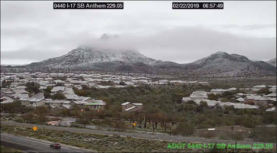 A rare sight of snow on the foothills and rooftops along Interstate 17 at Anthem on Feb. 22, 2019.