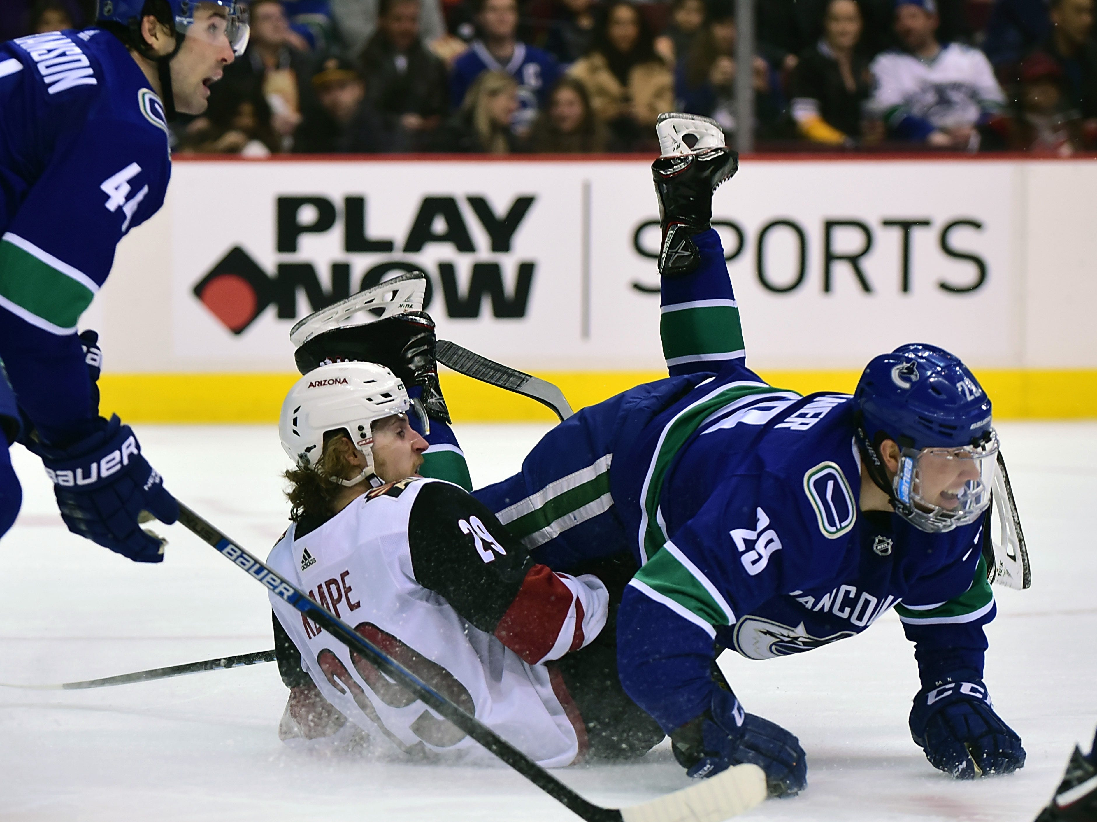 Feb 21, 2019; Vancouver, British Columbia, CAN; Arizona Coyotes forward Mario Kempe (29) collides with Vancouver Canucks defenseman Ashton Sautner (29) during the second period at Rogers Arena. Mandatory Credit: Anne-Marie Sorvin-USA TODAY Sports